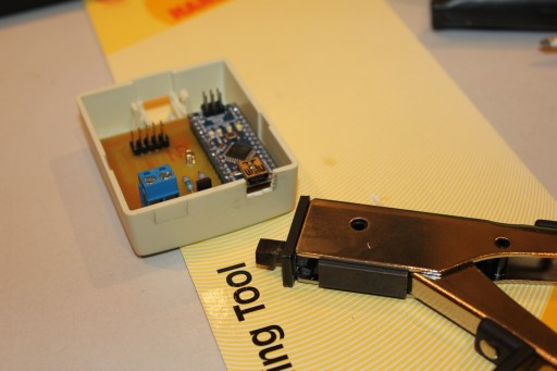 Using a nibbler to customize enclosure